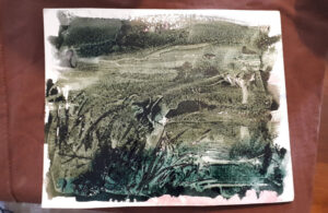 Photo of printing plate with paint on it.