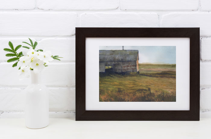 Link to Old Barn page. Photo of barn painting leaning against a wall beside a vase of flowers.