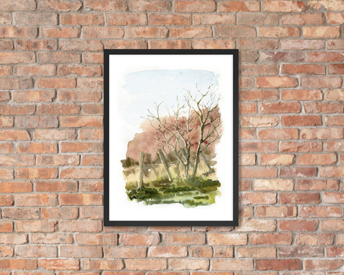 Photo of framed painting of a bicyclist on Fall Trees. Painting on a brick wall.