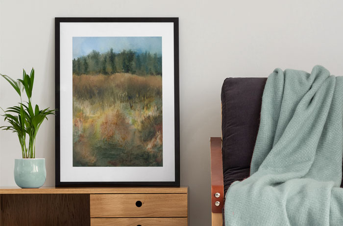 Photo of Magic Field in a frame leaning against the wall next to chair.