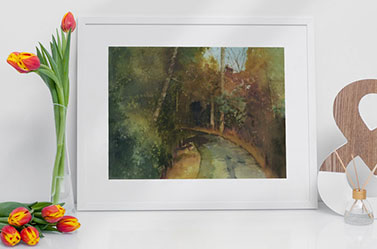 Link to Forest Path page. Photo of framed painting of path leading into trees. Painting leans against a wall next to flowers.
