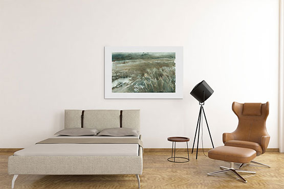 Photo of a watercolor painting of a muddy field on a wall above a couch.