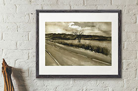 Link to Roadside Field page. Photo of a painting of a field with a tree and a highway in front. Painting is on a wall.